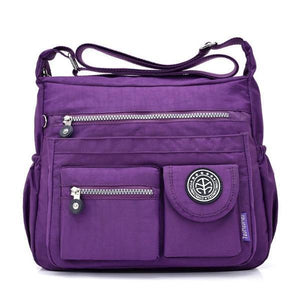 Purple crossbody travel bag water bottle holder