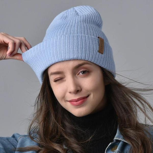 woman wearing fluffy beanie hat