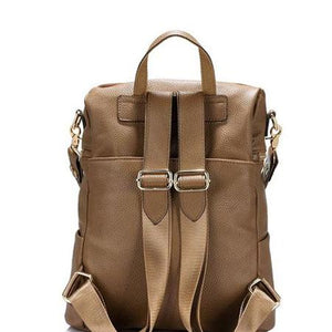 Leather backpack with large rear zipper pocket