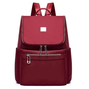 Red backpack with large top opening for women