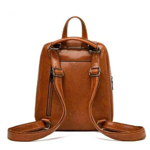 Brown leather backpack with convertible strap