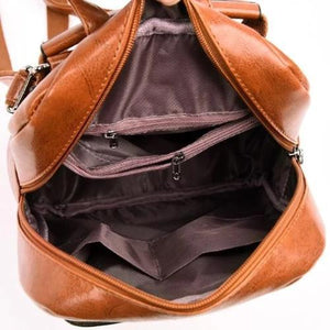 Leather backpack with zipper interior compartment