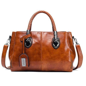 Brown leather handbag with triple compartment