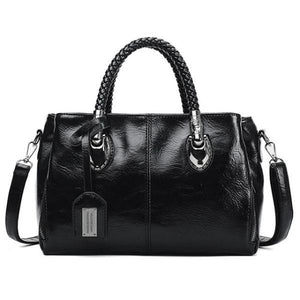 Black leather handbag with triple compartment