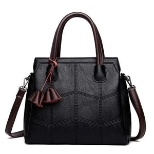 Black leather cross body handbags with top handles