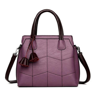 Purple leather cross body handbags with top handles