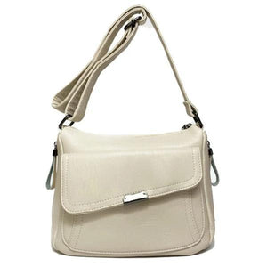 White leather crossbody bag with large front pocket