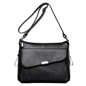 Black leather crossbody bag with large front pocket
