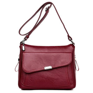 Red leather crossbody bag with large front pocket