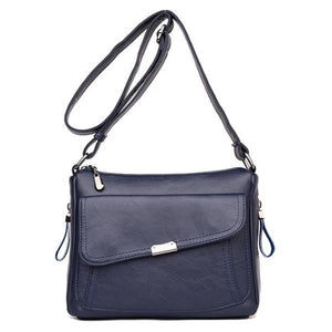 Blue leather crossbody bag with large front pocket