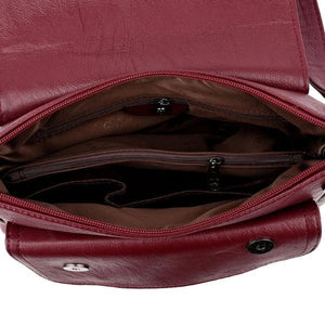 red leather handbag with pocket in the middle