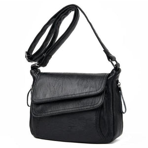 Black leather crossbody bag with lots of pockets