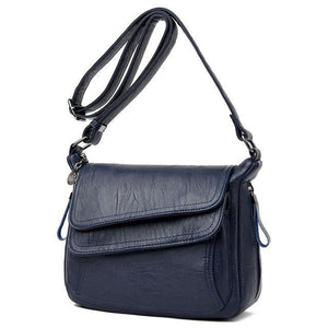Blue leather crossbody bag with lots of pockets
