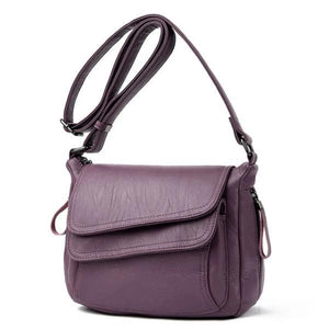 Purple leather crossbody bag with lots of pockets