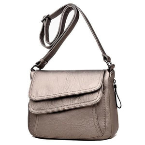 Bronze leather crossbody bag with lots of pockets
