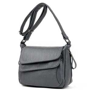 Gray leather crossbody bag with lots of pockets