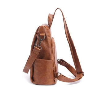 Leather backpack with side bottle holder compartment