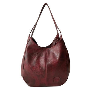 Red triple compartment leather shoulder bag