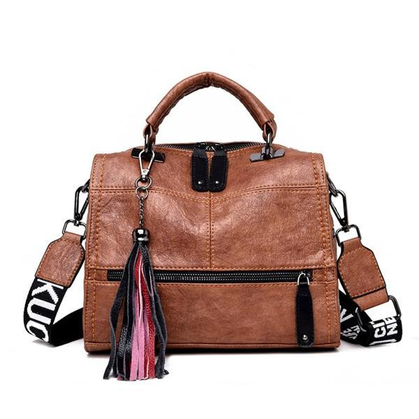 Brown crossbody leather bag with front zipper pocket and tassles