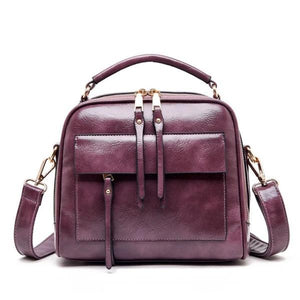 Pink leather crossbody bags with multiple compartments