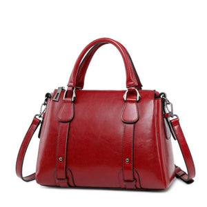 Red leather crossbody purse with handles