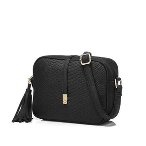 Black faux snakeskin crossbody bags