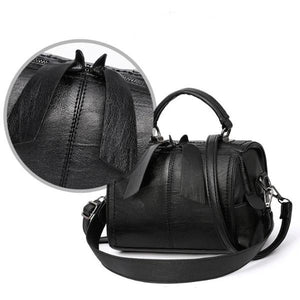 Black leather barrel bag