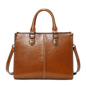Brown leather cross body handbags with top handles