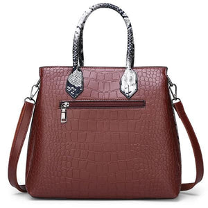 snakeskin and crocodile leather handbag