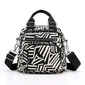 Zebra print crossbody backpak bag