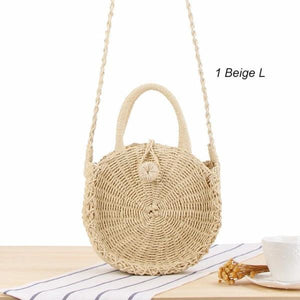 Beige straw crossbody bag with shoulder strap