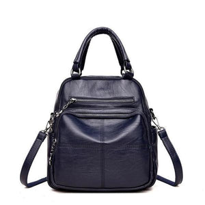 Blue vegan leather convertible backpack purse