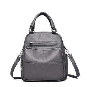 Gray vegan leather convertible backpack purse