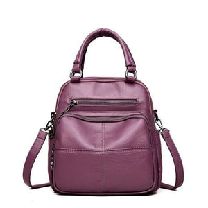 Purple vegan leather convertible backpack purse