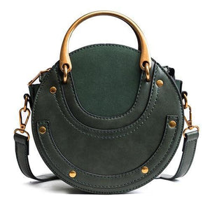 Green round crossbody bag with metal handles