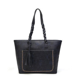 Blue leather tote bag with tassels