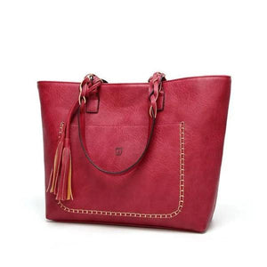 Red leather tote bag with tassels