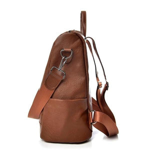 Brown leather backpack with side bottle compartement
