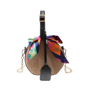 Straw bag with handle and gold chain crossbody strap