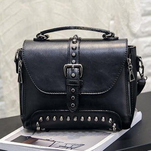 Black Vintage handbag with rivets and spikes