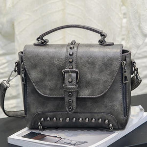 Gray Vintage handbag with rivets and spikes