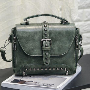 Green Vintage handbag with rivets and spikes