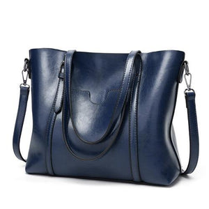 Deep blue leather crossbody tote