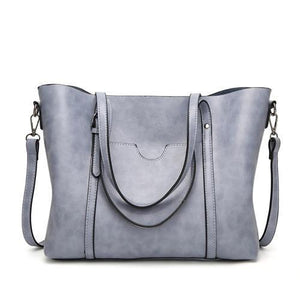 Light blue leather crossbody tote