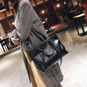 Black crossbody tote bag leather