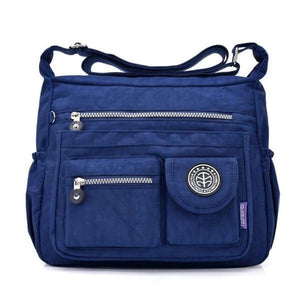 Dark blue crossbody travel bag water bottle holder