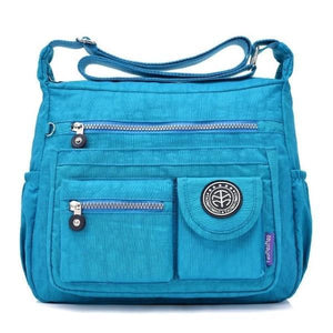 Light blue crossbody travel bag water bottle holder