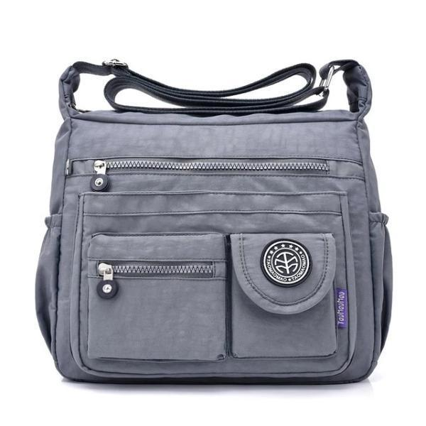 Grey crossbody travel bag water bottle holder