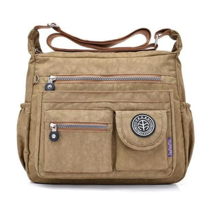 Khaki crossbody travel bag water bottle holder