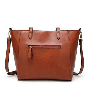 Brown tote bag with back zipper pocket